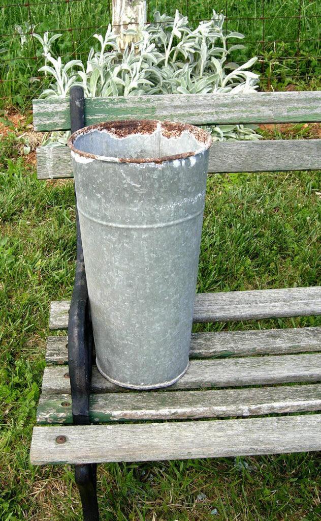 Plain Metal Flower Bucket on bench