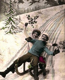 Couple Sledding in Snow