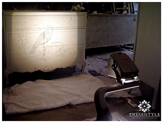 Use a projector to transfer an image onto furniture.