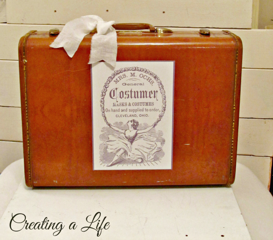 Vintage Suitcase with Advertisement