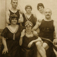 Old photo of men and women wearing bathing suits
