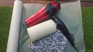 Some-wax-paper-a-candle-and-a-hair-dryer