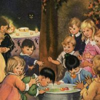 A group of young children bobbing for apples