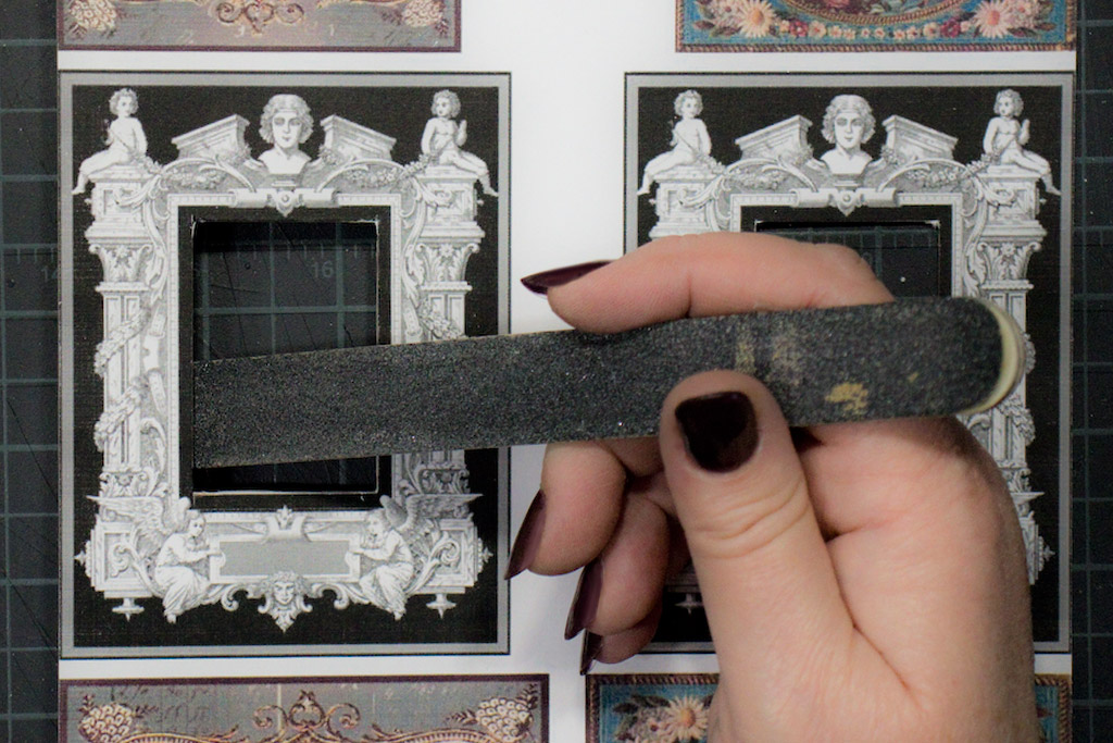 darken the exposed chipboardpaper edges with a black permanent marker - Miniature Frames