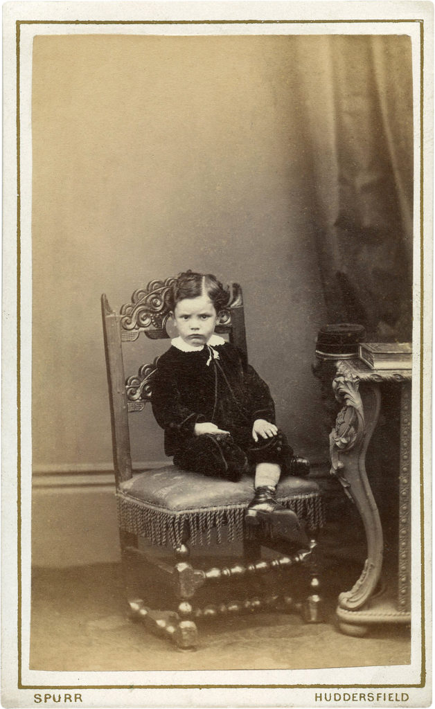 Old Photo Stubborn Child in Fancy Chair Image!