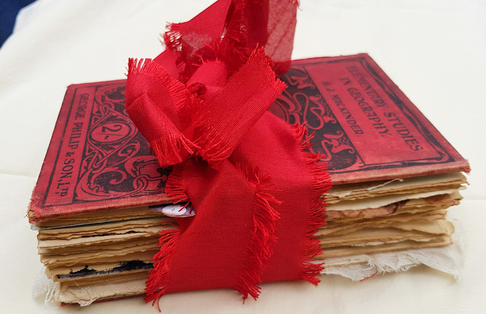 Junk Journal From SIde Wrapped with Red Bow
