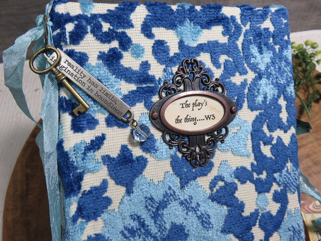 Theatre Junk Journal Cover Close Up funky blue vintage upholstery fabric