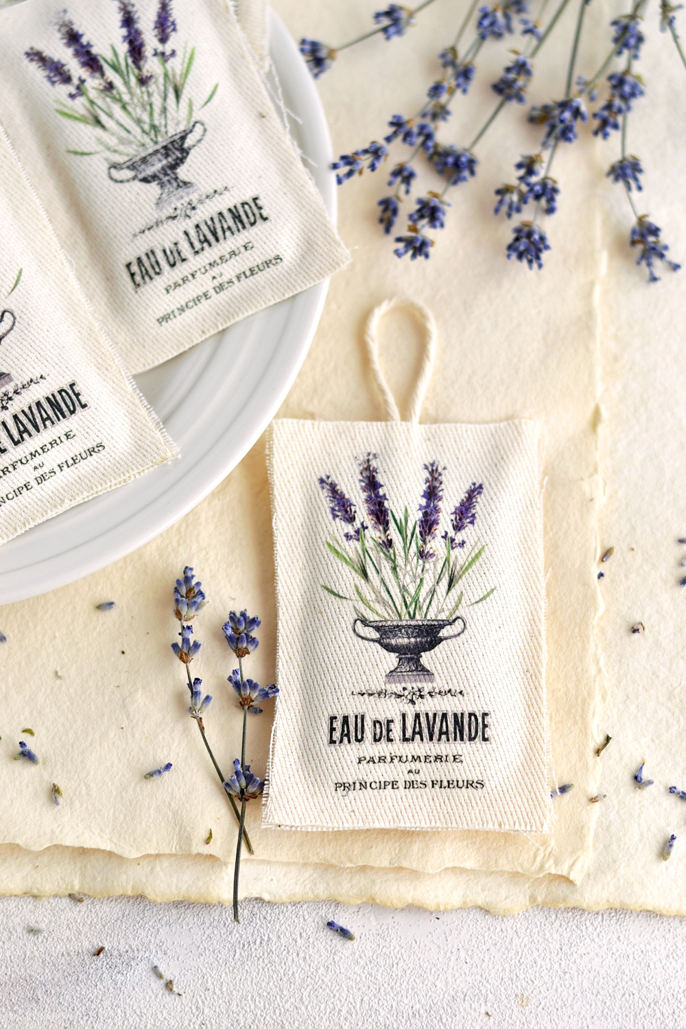 Learn how to make these DIY No Sew Lavender Sachets using the iron on image transfer technique, scrap pieces of fabric and your glue gun! Free printable included! #frenchephemera #nosew #vintage #lavender #lavendersachets #diy #ironontransfer #imagetransfer