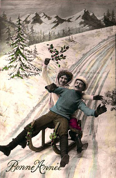 couple sledding vintage photo image