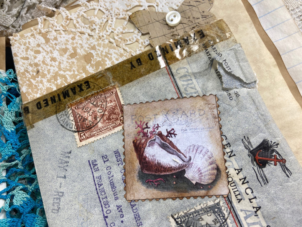 Seashells and ephemera in Junk Journal