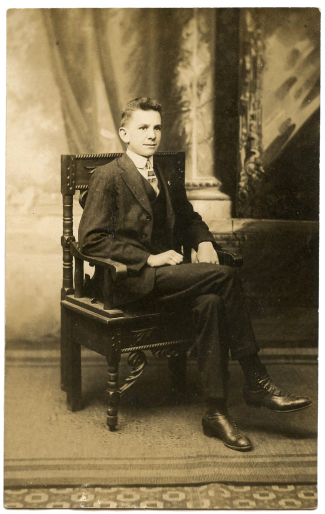 vintage man sitting chair photo image