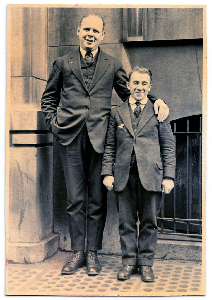 old photo short man tall man image