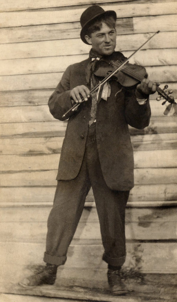 vintage photograph man playing violin fiddle clipart