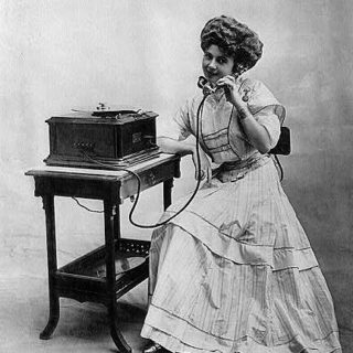 girl talking antique telephone image