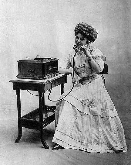 girl talking antique telephone image