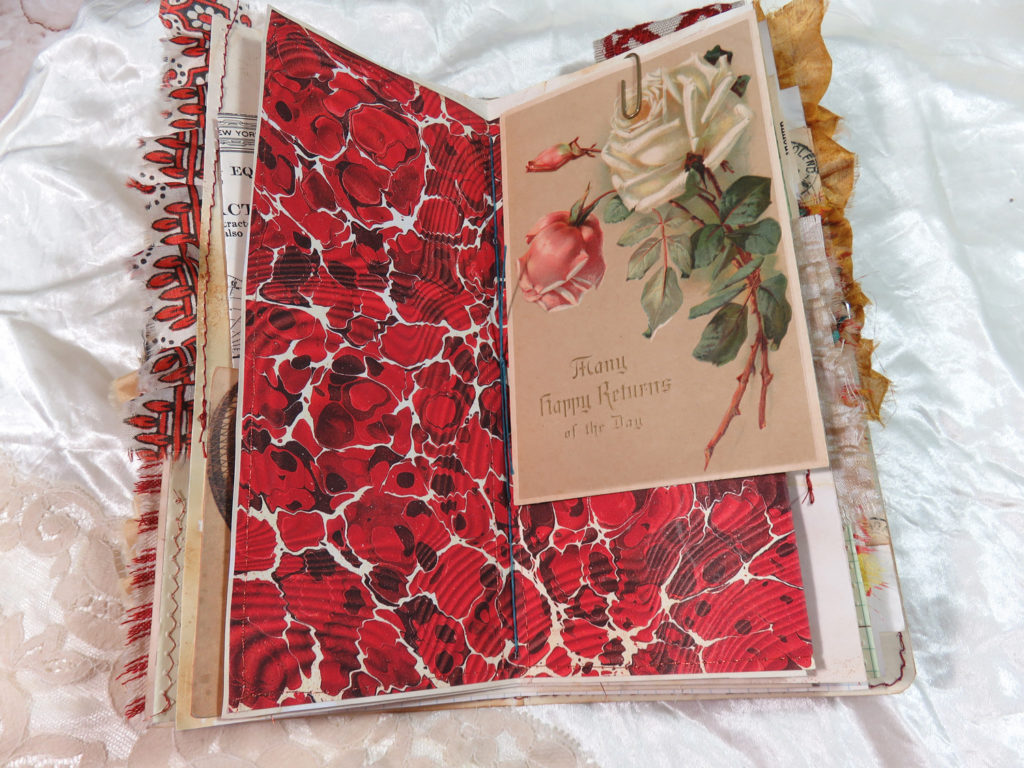 red marbled end paper journal page