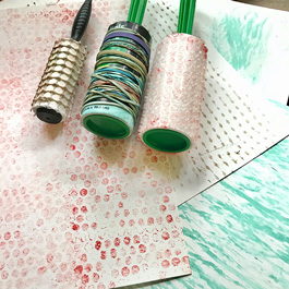 Rollers with printed paper