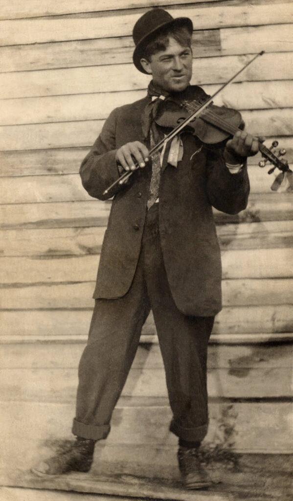vintage photo man playing fiddle image