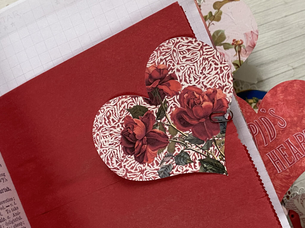 red paper sack journal page heart tab