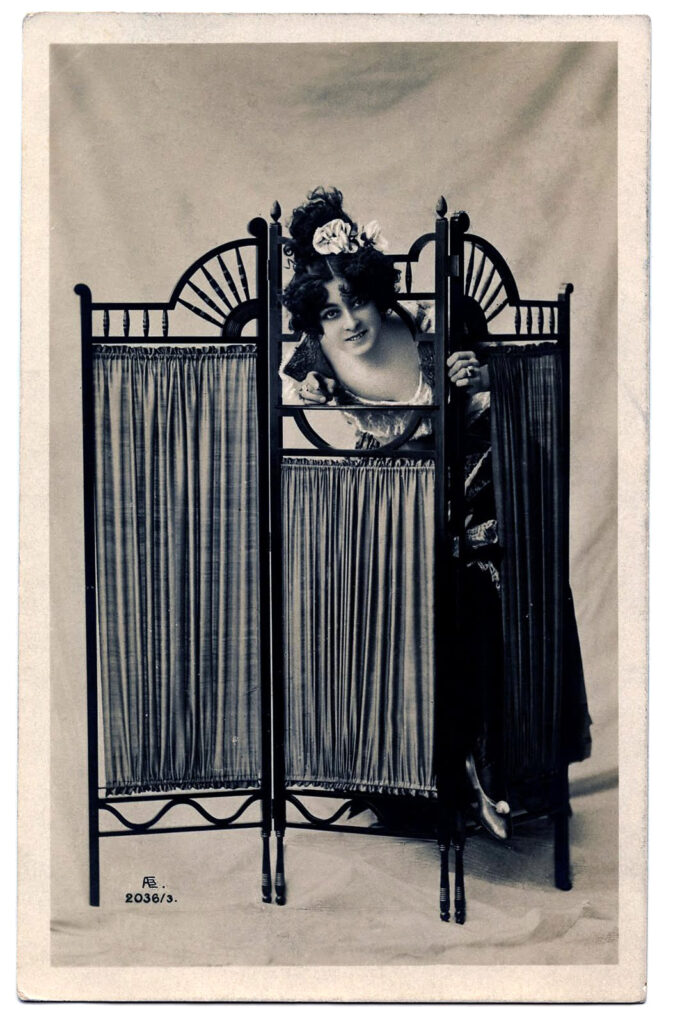 Photo of Actress peeking over Dressing Screen