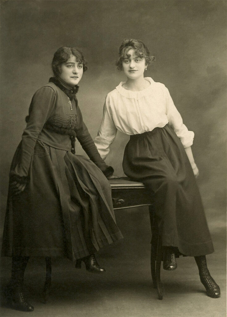 two sisters leaning image