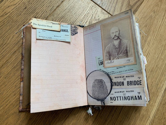 thumbprint magnifying glass journal page