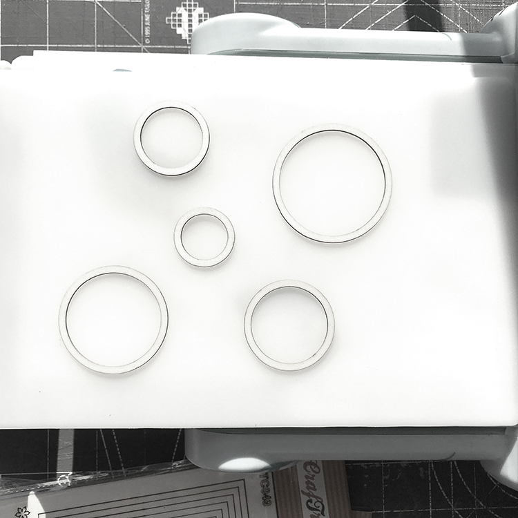 Chipboard Circle Design Arranged on Impressions Pad