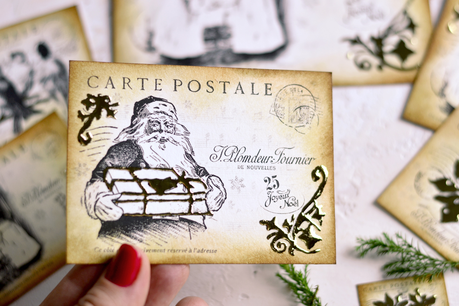 hand holding a beautiful Santa with gift Christmas postcard decorated with gold foil