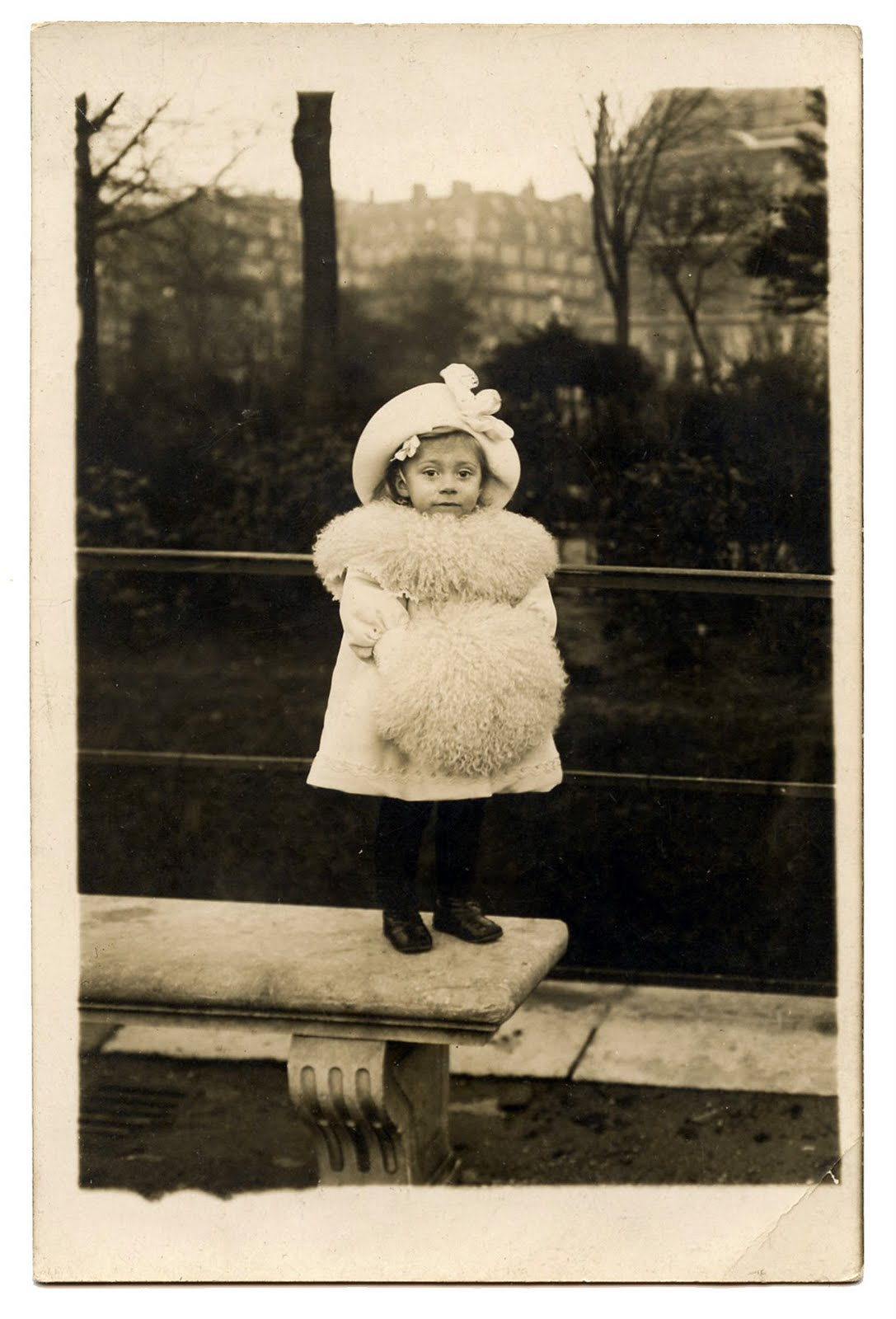 Old photo tiny girl dressed for winter the graphics fairy